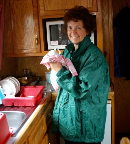 Peggy doing dishes in our tiny galley