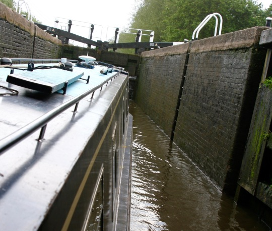 Piloting boat into lock on Trent and Mercy Canal