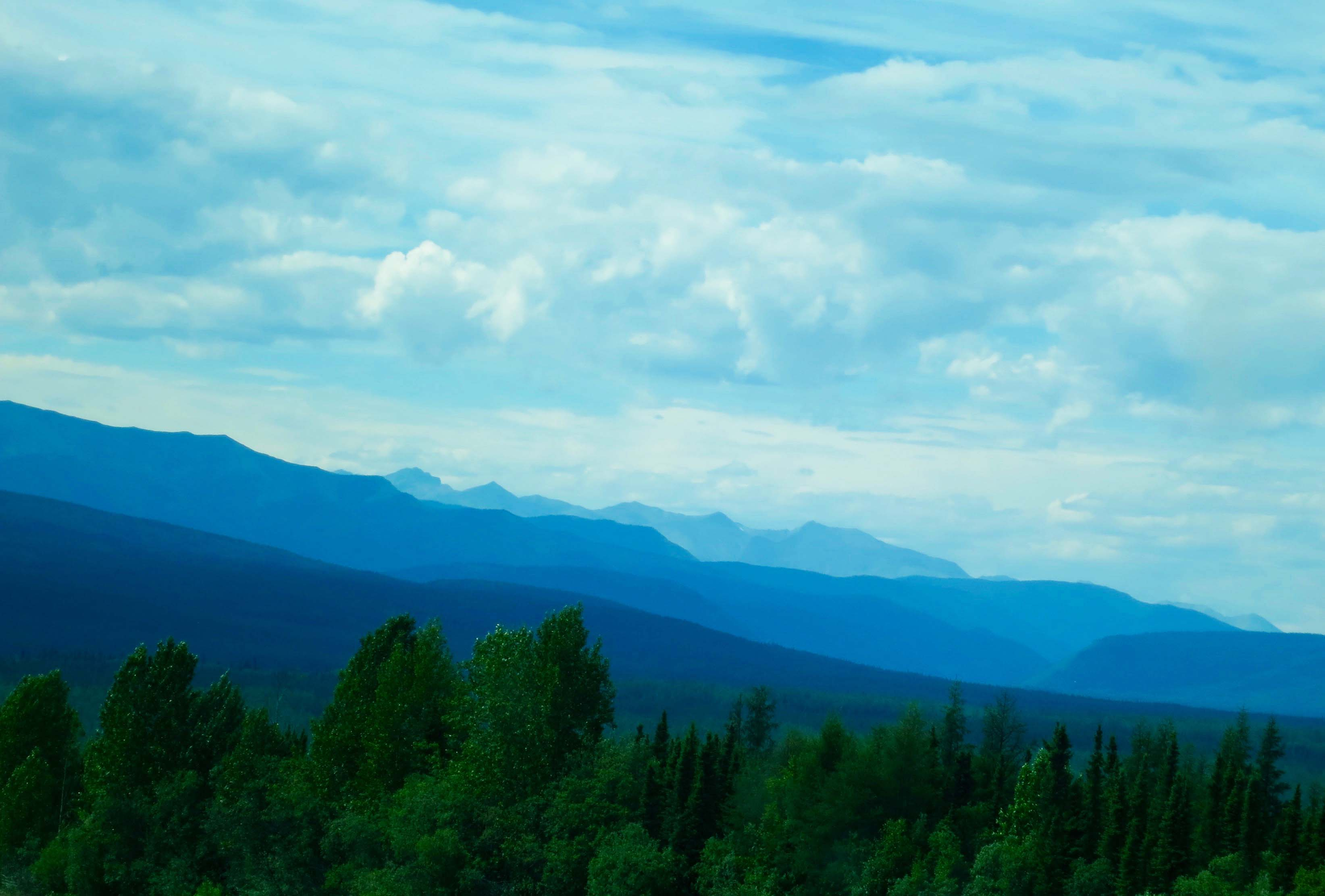 Blue mountains along the Alaska Highway in British Columbia