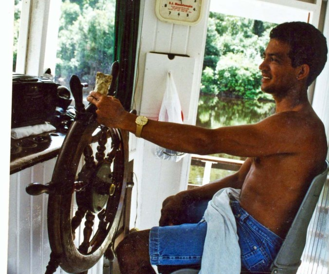 Bone with river boat pilot on Amazon River