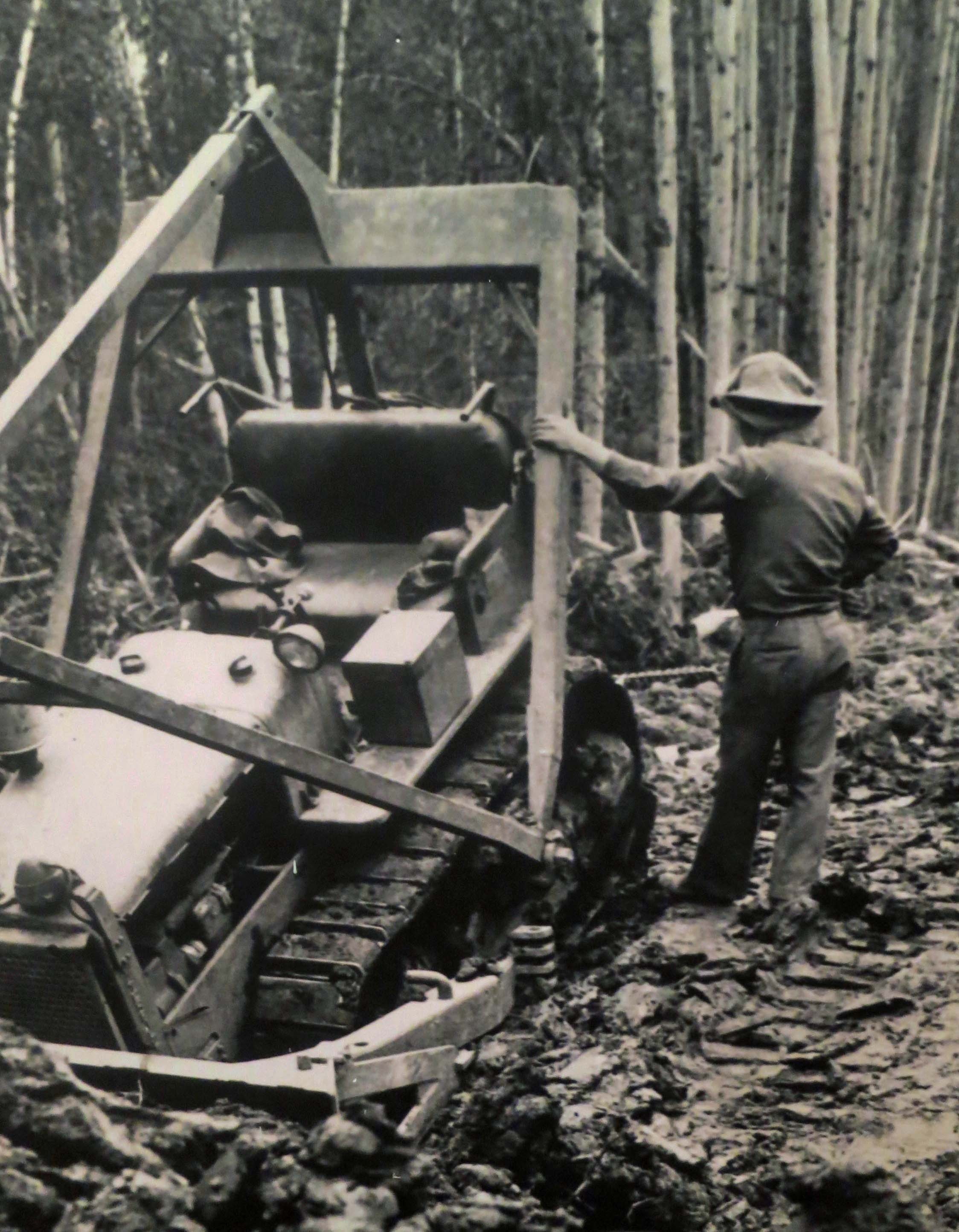 Bulldozer buried in mud while building the Alaska Highway