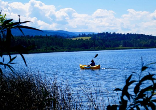 Peggy kayaking on Dragon Lake, Quesnel, BC