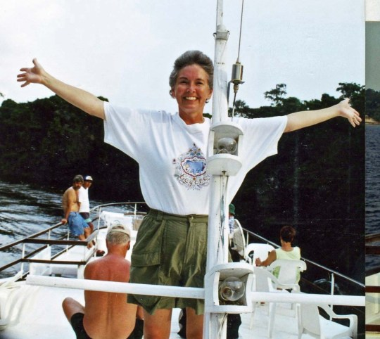 Peggy Mekemson assuming a Titanic pose on an Amazon riverboat