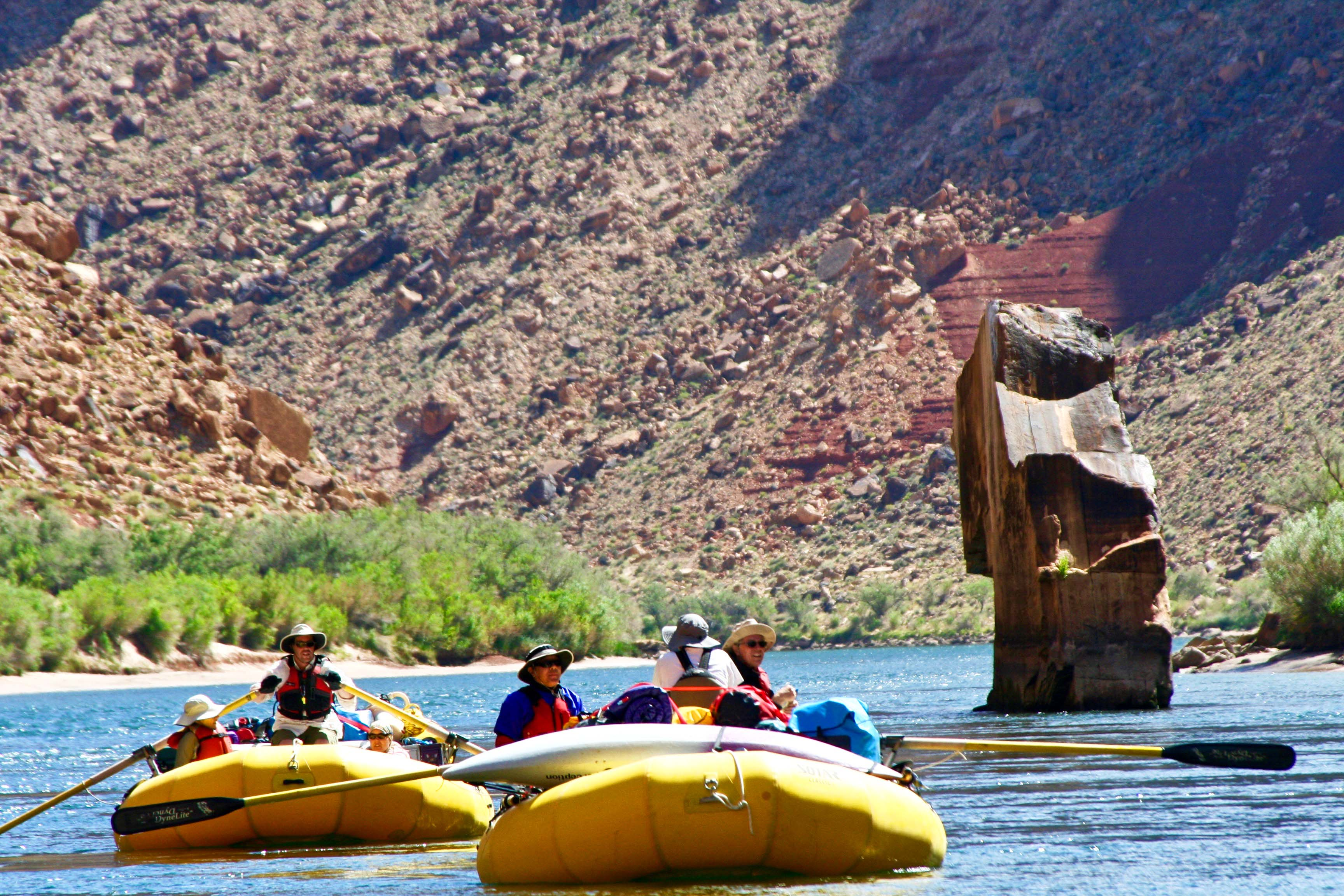 Rafters pass Ten Mile Rock on the Colorado River in the Grand Canyon