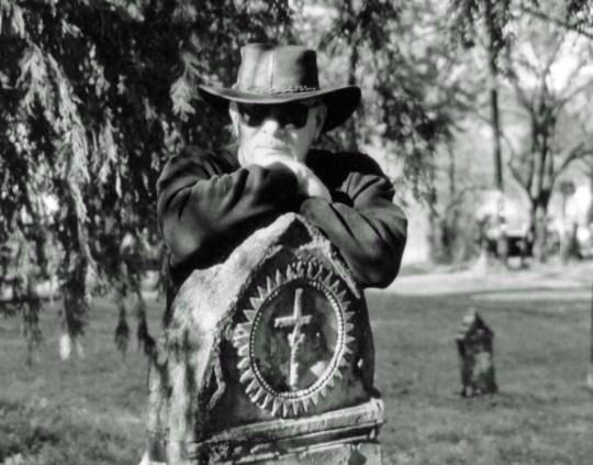 Resting on top of tombstone in Diamond Springs, CA