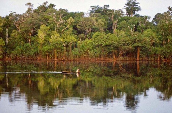 Small boat on Rio Negro River in Brazil