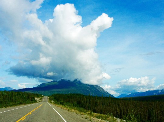 clouds and mountains along alaska highway