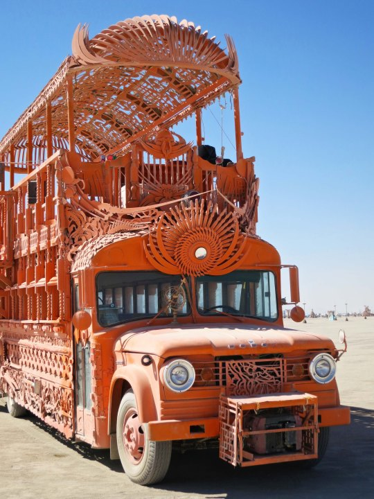 Orange mutant vehicle  bus at Burning Man.