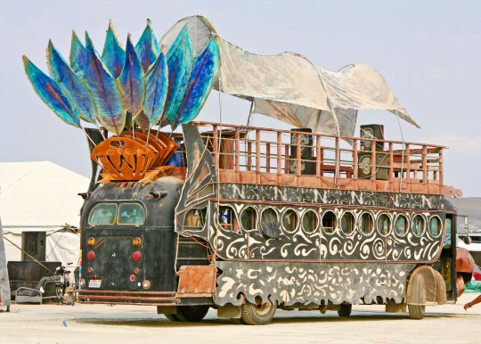 Mutant bus with tail feathers at Burning Man.