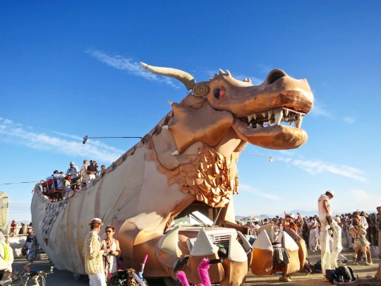Large claws on golden dragon mutant vehicle at Burning Man.