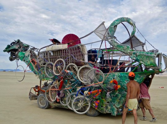 Bikes loaded on a green dragon mutant vehicle at Burning Man.