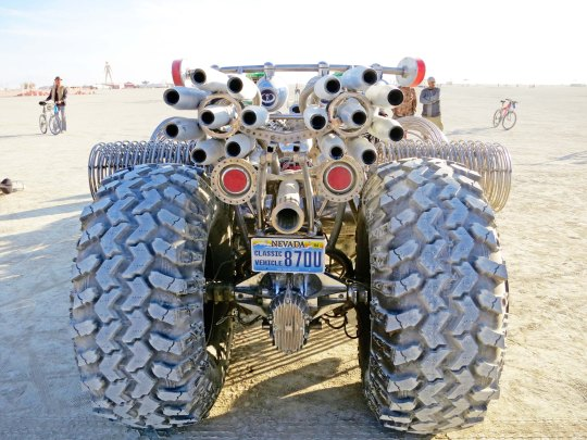 Exhaust pipes on mutant vehicle hot rod at Burning Man.