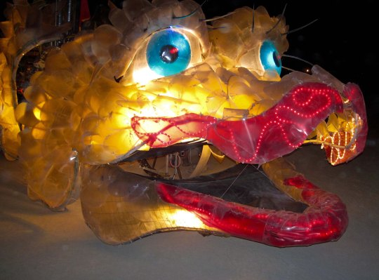 Mutant vehicle dragon at night in Burning Man.