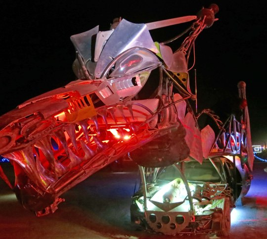 Red snouted mutant vehicle dragon at Burning Man.