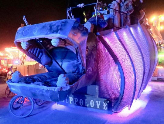 Hippo mutant vehicle at Burning Man at night.
