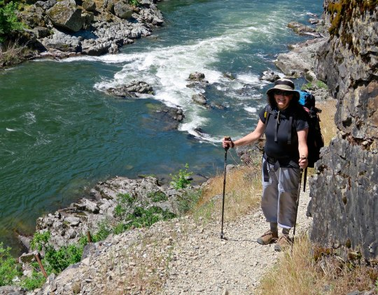 Peggy Mekemson hiking along the Rogue River Trail.