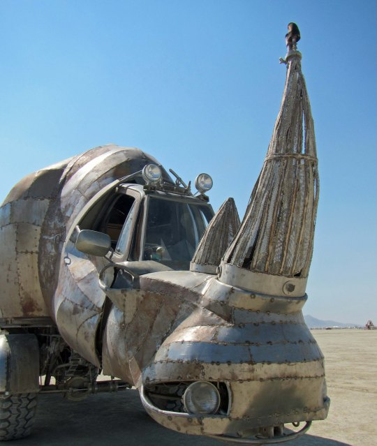 Head shot of large mutant rhino vehicle at Burning Man.