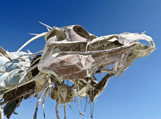 Head shot of scary mutant vehicle dragon at Burning Man.