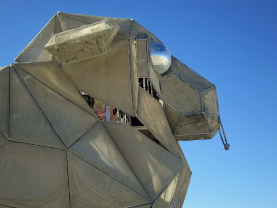 Profile of large sheep mutant vehicle at Burning Man