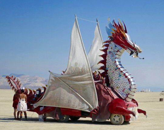 Silver and red mutant vehicle dragon at Burning Man.