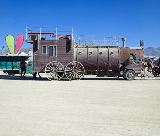 Side view of mutant vehicle train at Burning Man.