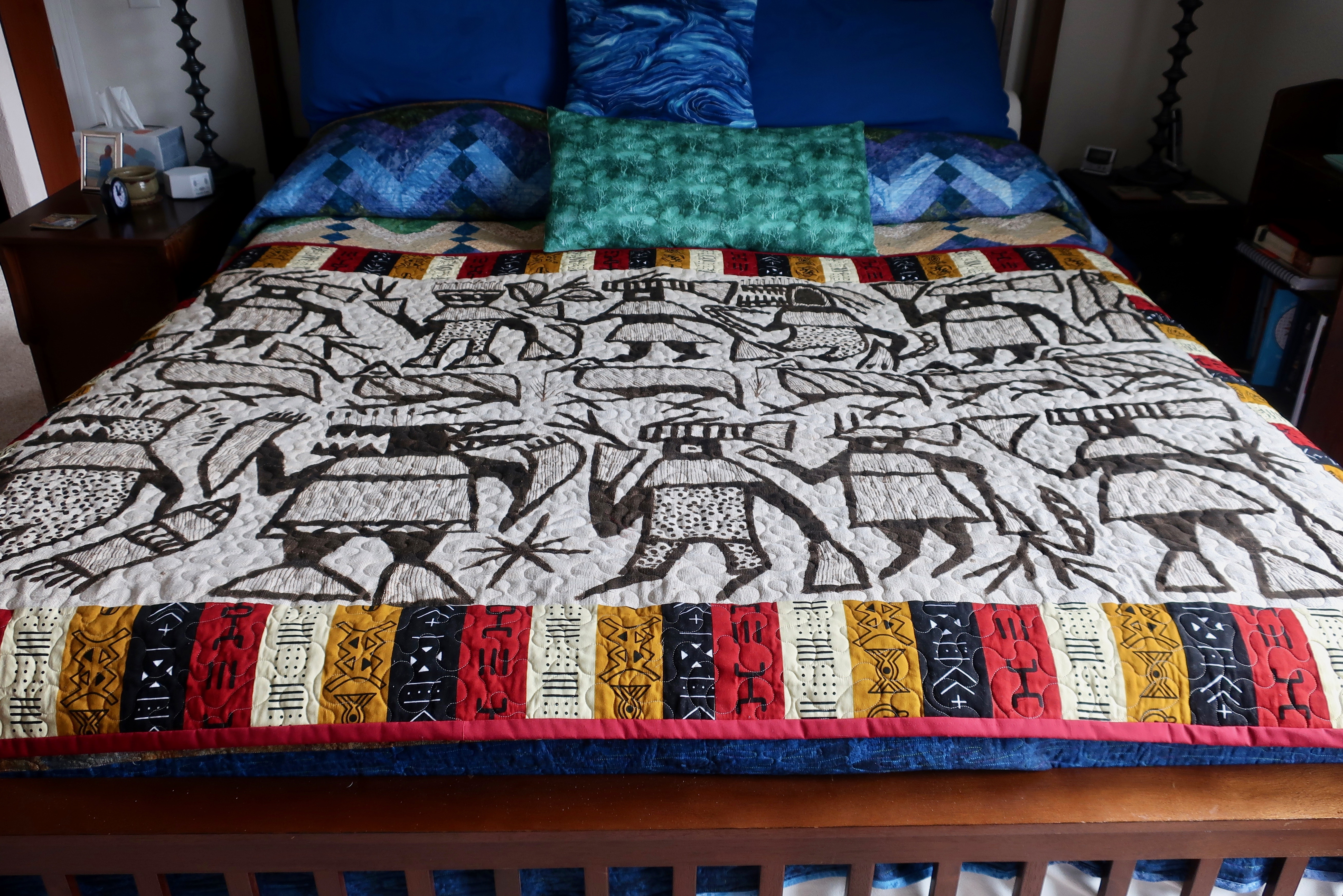Bed quilt featuring Liberian country cloth. Photo bt Curt Mekemson.